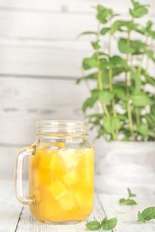 Mango juice in mason jar