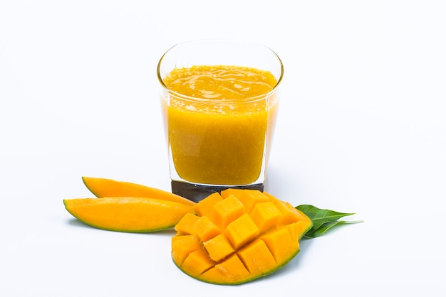 Mango juice with slice and leaf isolated