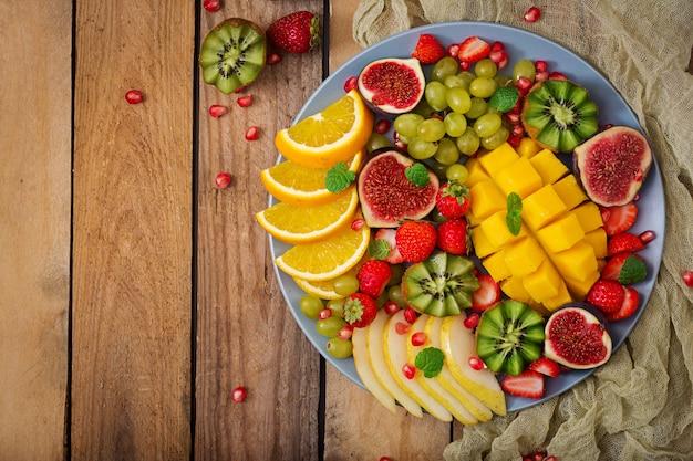 Mango, kiwi, fig, strawberry, grapes, pear and orange