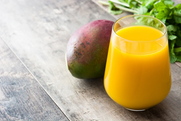 Mango lassi dessert traditional indian drink on wooden table copyspace