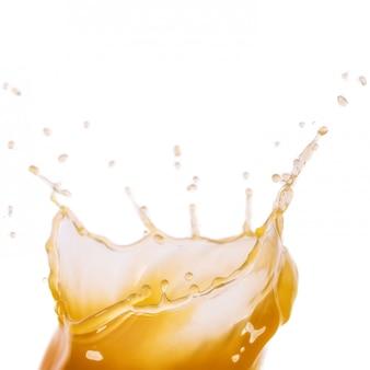 Mango, orange or liquid splashing isolated on white