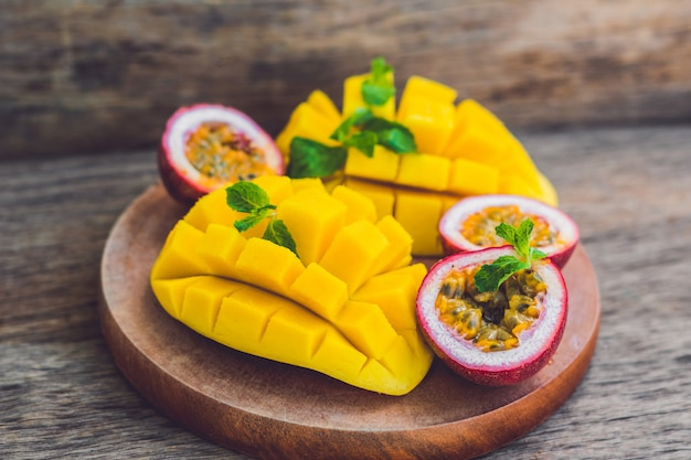 Mango and passion fruit on an old wooden background