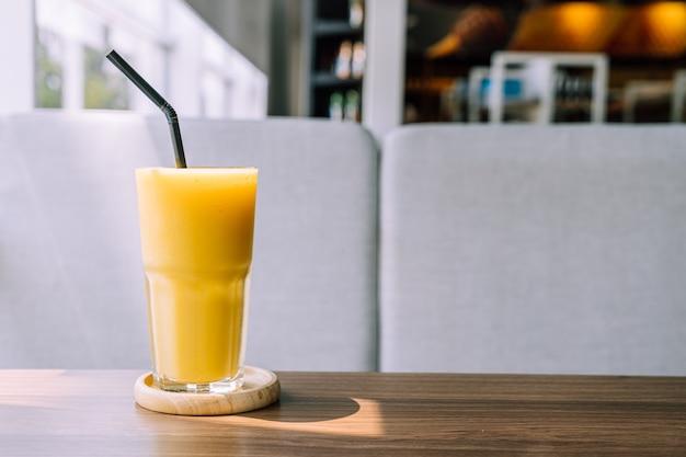 Mango smoothie glass in cafe restaurant