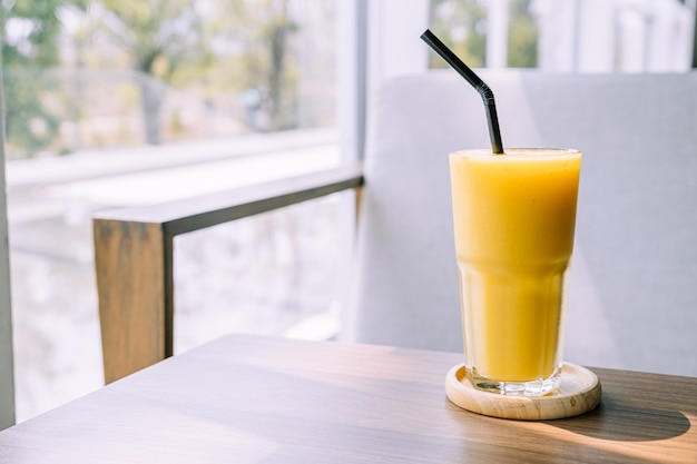 Mango smoothie glass in cafe