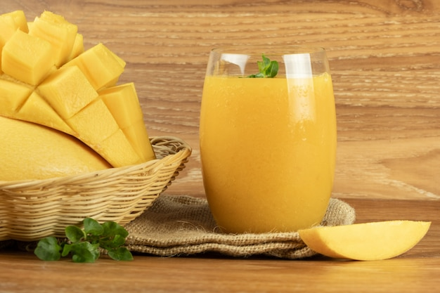 Mango smoothie juice. wooden background.