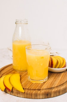 Mango smoothie with white background