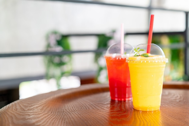 Mango smoothies glass in cafe