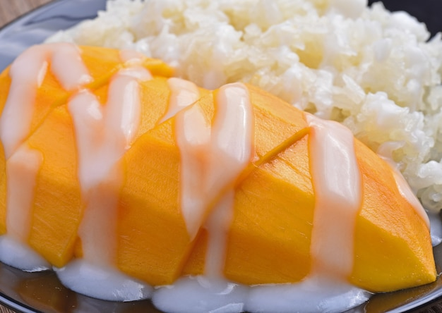 Mango sticky rice topped with coconut milk