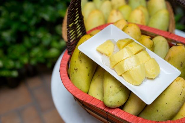 Mango tropical fruit in wooden basket