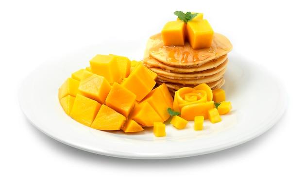 パンケーキとハニーシロップのデザートがおいしいマンゴー