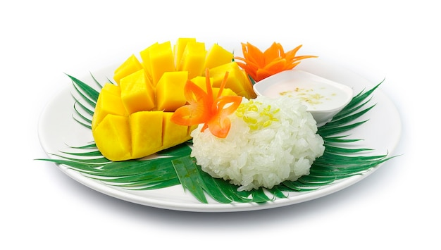 Mango with sticky rice served coconut milk sauce thai dessert sweet dish decorate with carved carrots side view