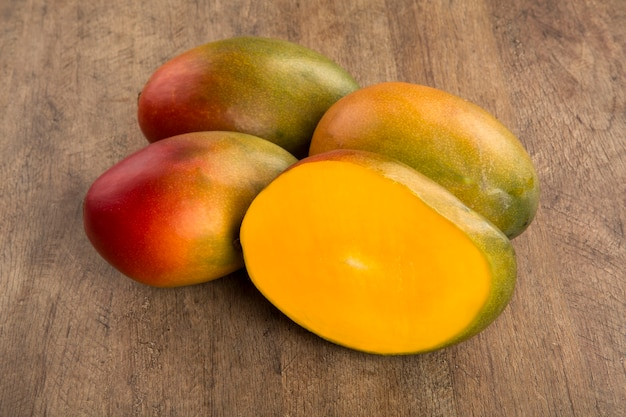 Mango on a wooden table. fresh fruits