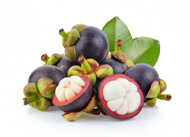 Mangosteen fruit of thailand with leaves on white table.