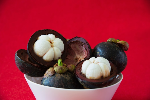 Mangosteen thai popular fruits - a tropical fruit with sweet juicy white segments of flesh inside a thick reddish-brown rind.