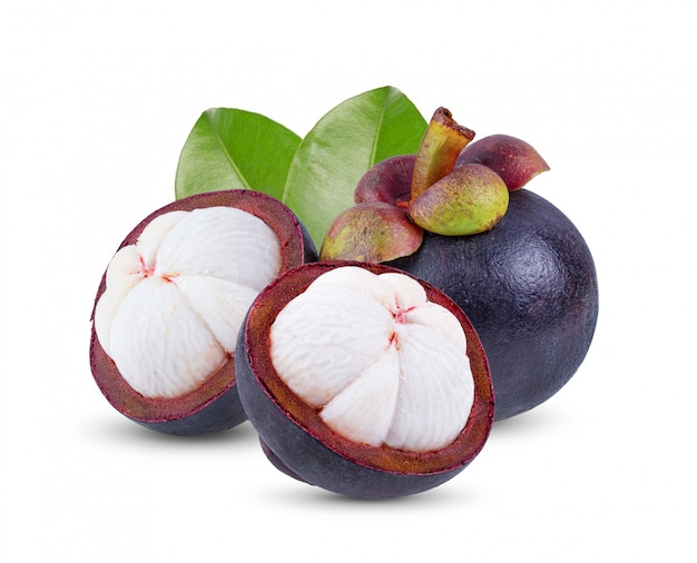 Mangosteen with leaves on white wall