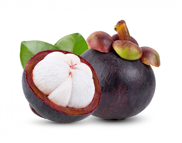 Mangosteen with leaves on white wall.