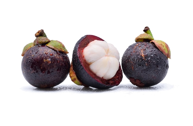 Mangosteen with water drops on white