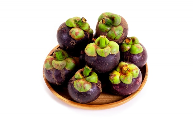 Mangosteen in wooden tray on white background