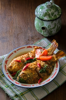 Mangut nila is traditional food from indonesia. made from fried fish mixed with spicy coconut curry sauce