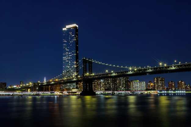 Manhattan bridge with brooklyn new york city skyscrapers city over hudson river new york, beautiful night scene