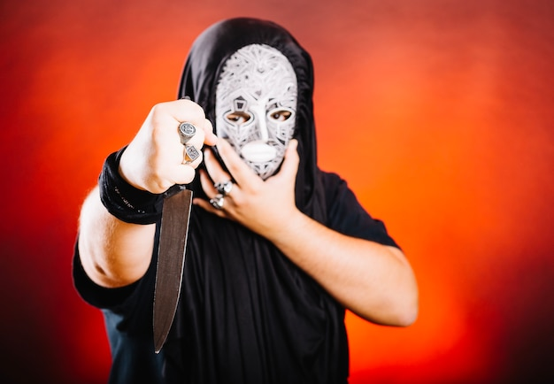 Maniac in mask and with knife