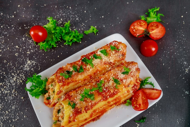 Manicotti baked with ham and cheese
