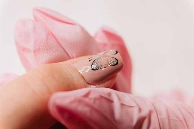 Manicure process. manicurist paints fingernails. nail polish.