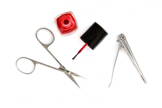 Manicure scissors and forceps isolated on white background.