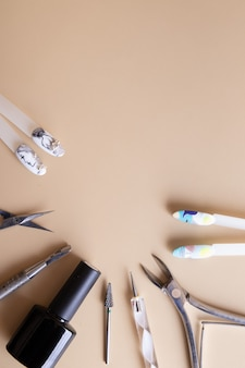 Manicure tools and tips with copy space drawings. gel polish coating vertical photo for stories