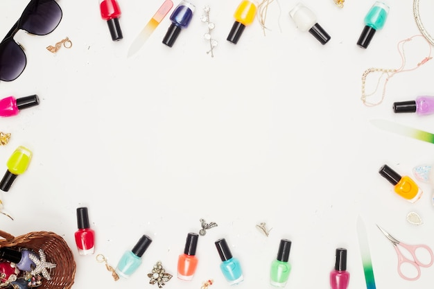 Manicure with nail polish, pedicure on white background