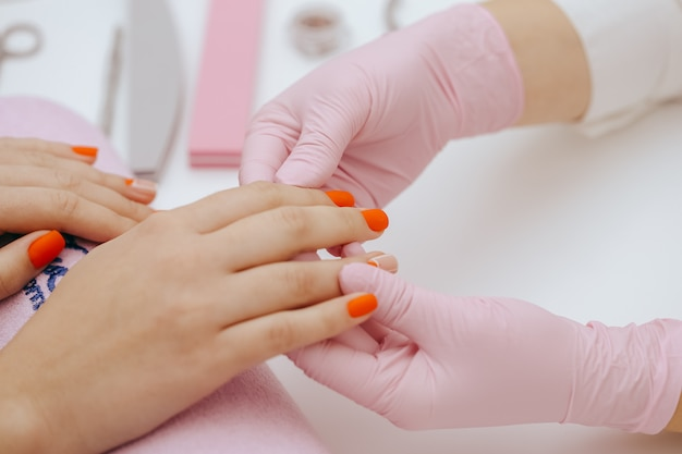 Manicurist does manicure