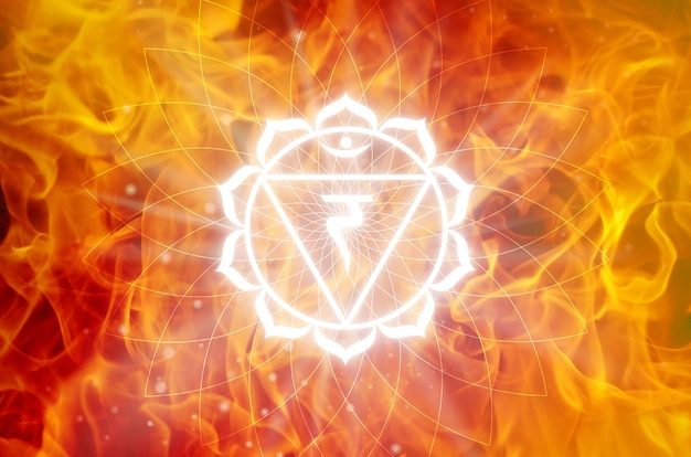 Manipura chakra symbol on a fire background. this is the third chakra, also called the solar plexus