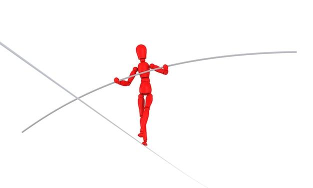 마네킹은 격리된 흰색 배경을 가진 슬랙라인에서 균형을 잡습니다.