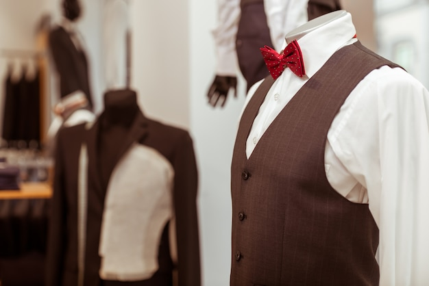 Mannequin in classical suit with bow tie.