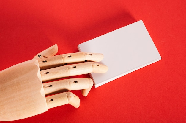 Mannequin hand holding white paper