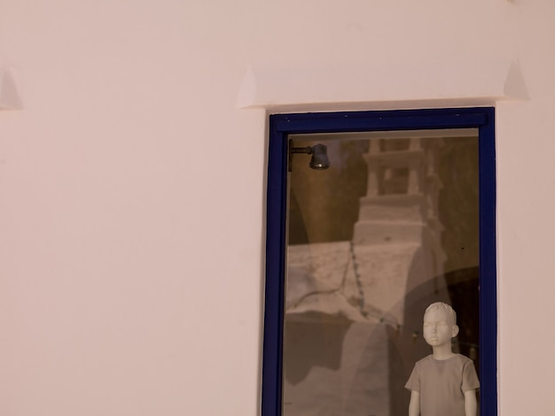 Mannequin in store window in mykonos greece