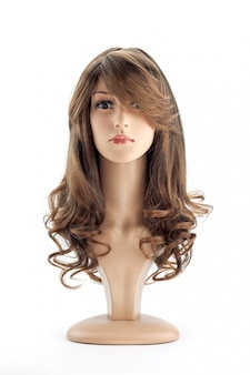 Mannequin woman head fake with curling hair wig on white background