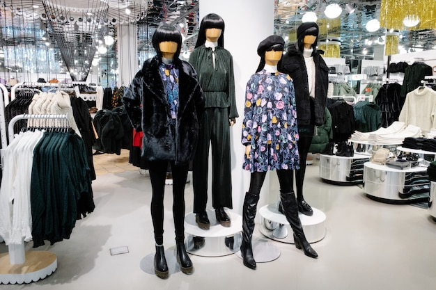 Mannequins dressed in female woman casual clothes in store of shopping center, autumn and winter collection