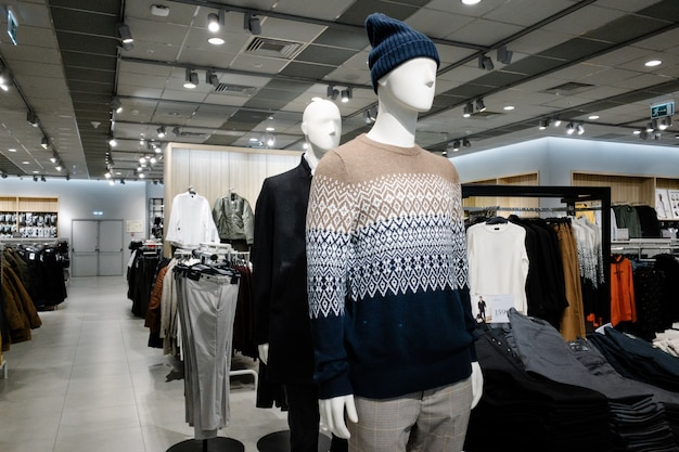 Mannequins dressed in male man casual clothes in store of shopping center, autumn and winter collection