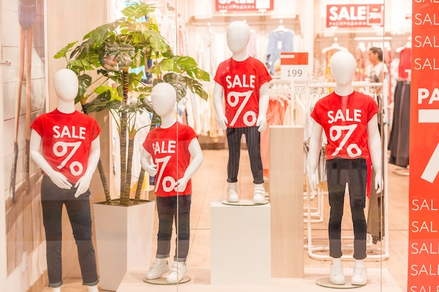 Mannequins in the kids store, sale concept.