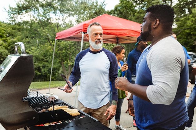 Manning the grill at a tailgate party