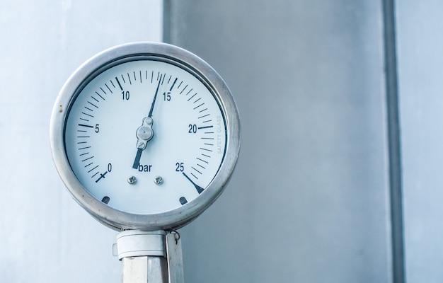 Manometer measuring water pressure gauge at industrial zone