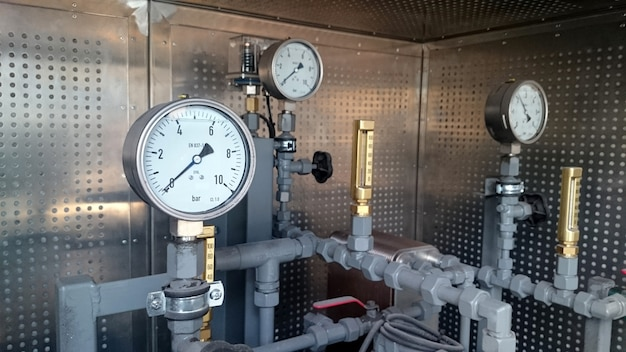 Manometers installed on the pipeline. measurement of water pressure in industrial plant.