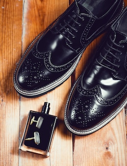 Mans accessories. shoes with perfume and cuff
