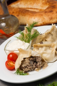 Manti or manty with chopped lamb and onion