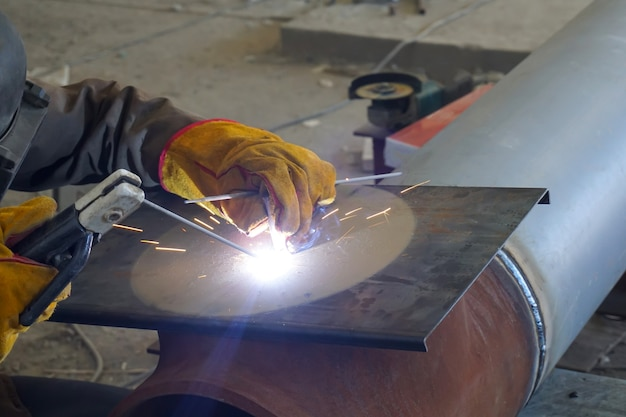 Manual arc welding of technological pipelines and metal structures for an oil refinery.