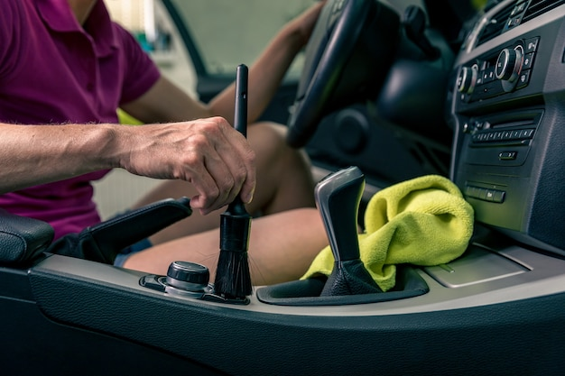 Manual cleaning of the car interior with the help of brushing