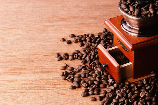 Manual coffee grinder on wooden table
