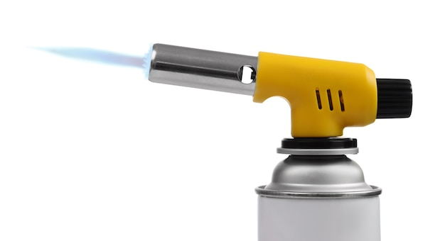 Manual gas torch burner (blowtorch) on spray can with blue flame for camping