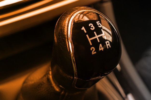 Manual gearbox transmission handle in the car close up